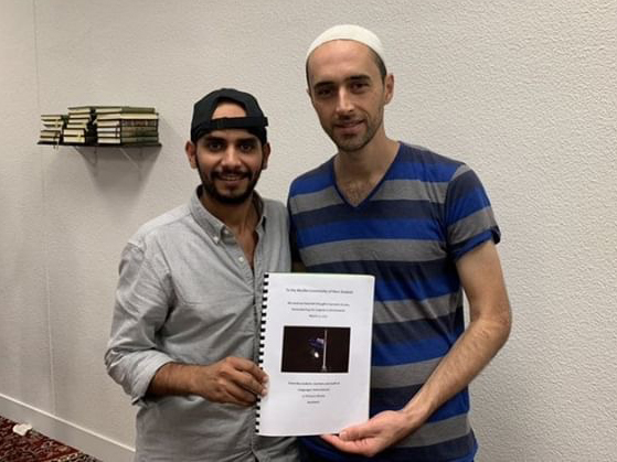Naif presenting the Memorial Book to the Imam at an Auckland mosque
