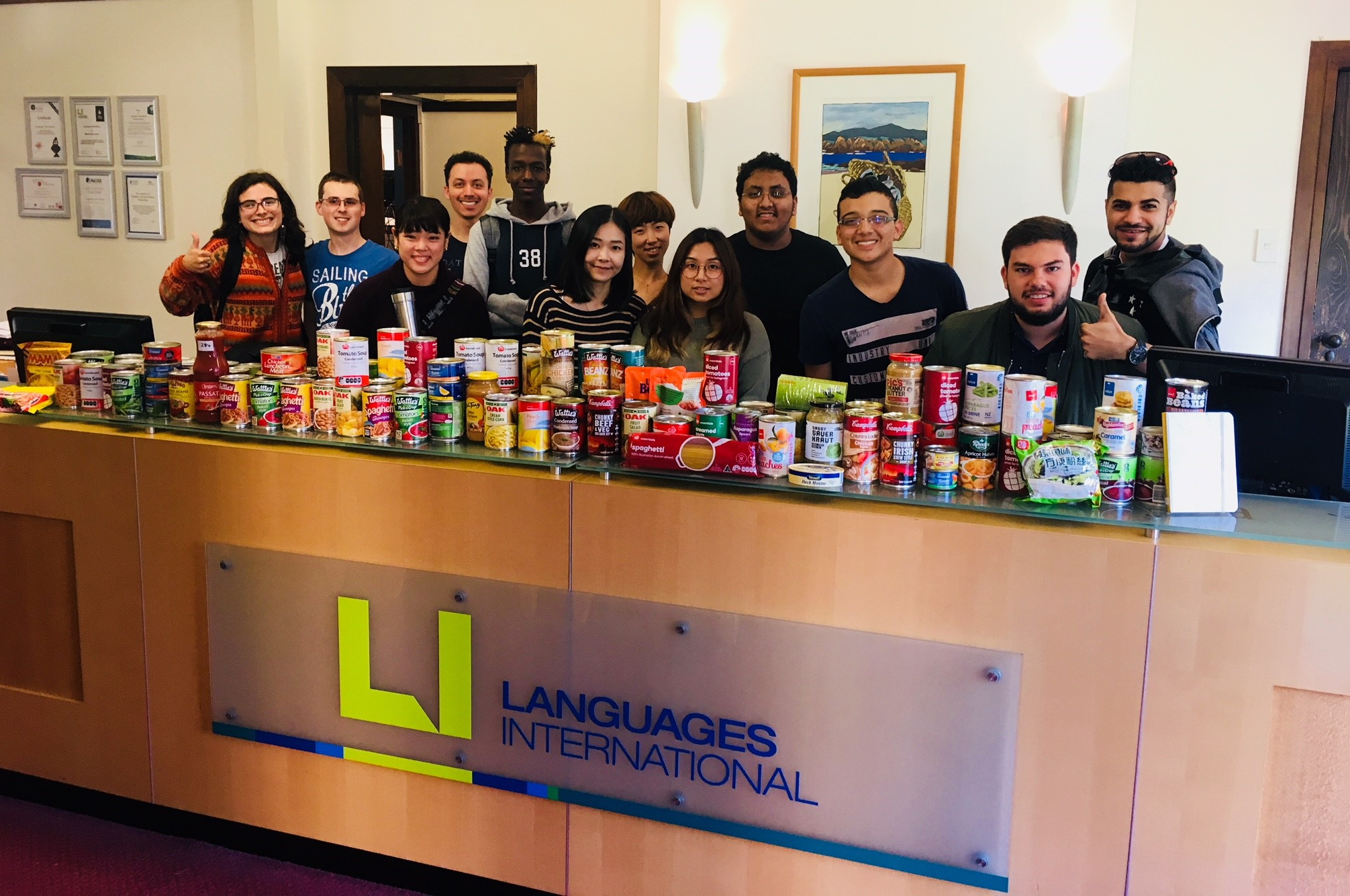 Languages International students and staff donating cans to Auckland City Mission