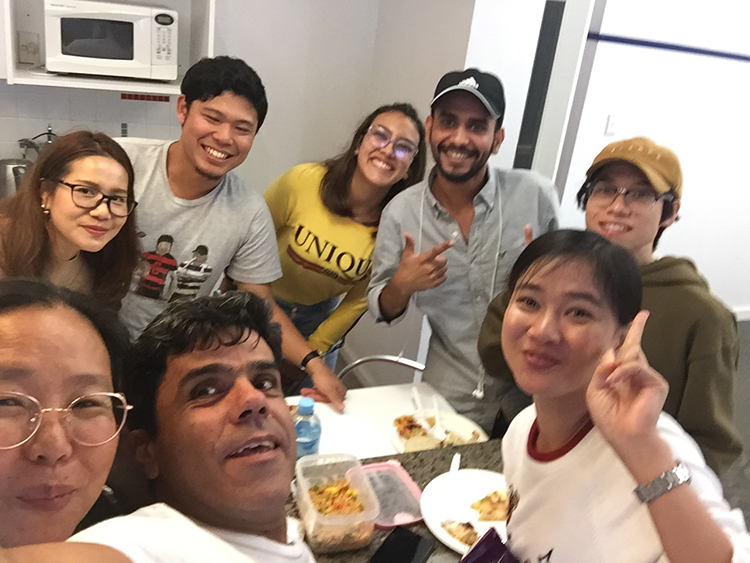 Students from around the world taking a selfie together at the shared lunch