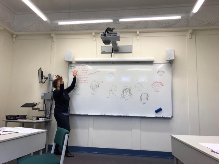 Teacher of English for University class at whiteboard