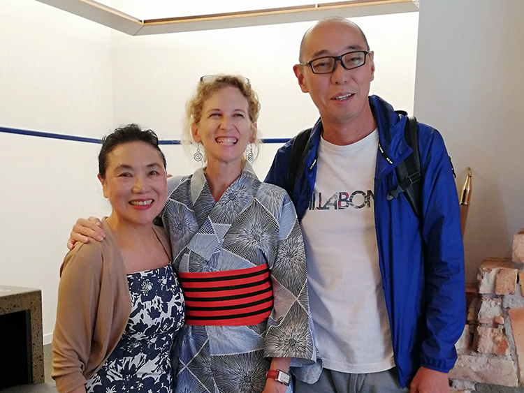 Two Japanese students with their English teacher in Auckland New Zealand, they have dressed their teacher in a kimono