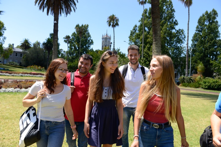 International English students learning English together in Albert Park in Auckland New Zealand