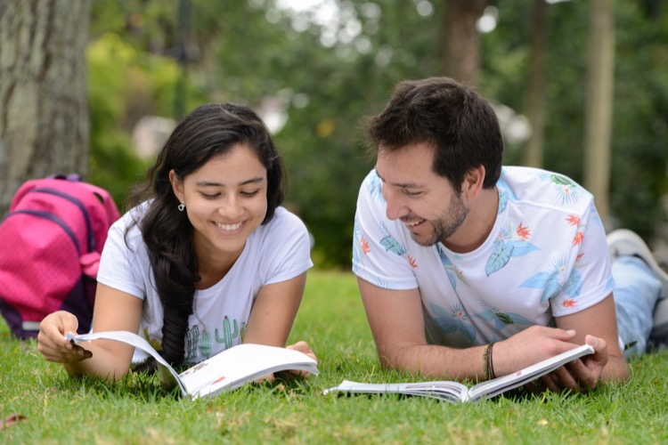 Two English students learning English in Albert Park in Auckland, New Zealand
