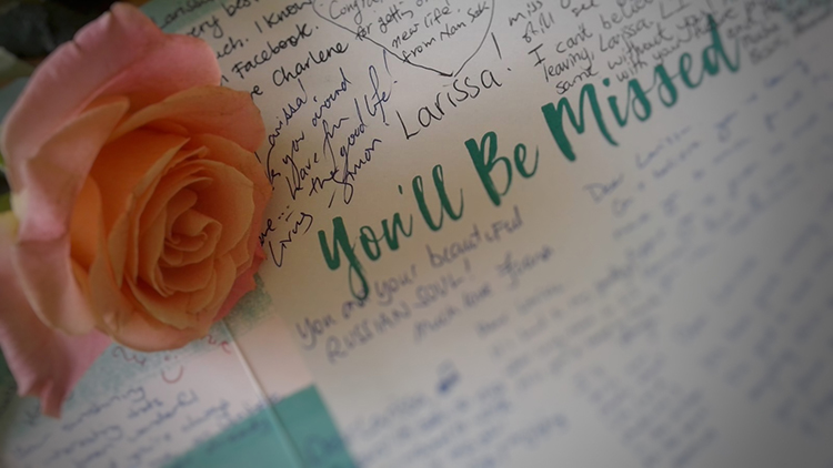 Larissa's farewell card and a pink rose from the bunch of flowers she was given