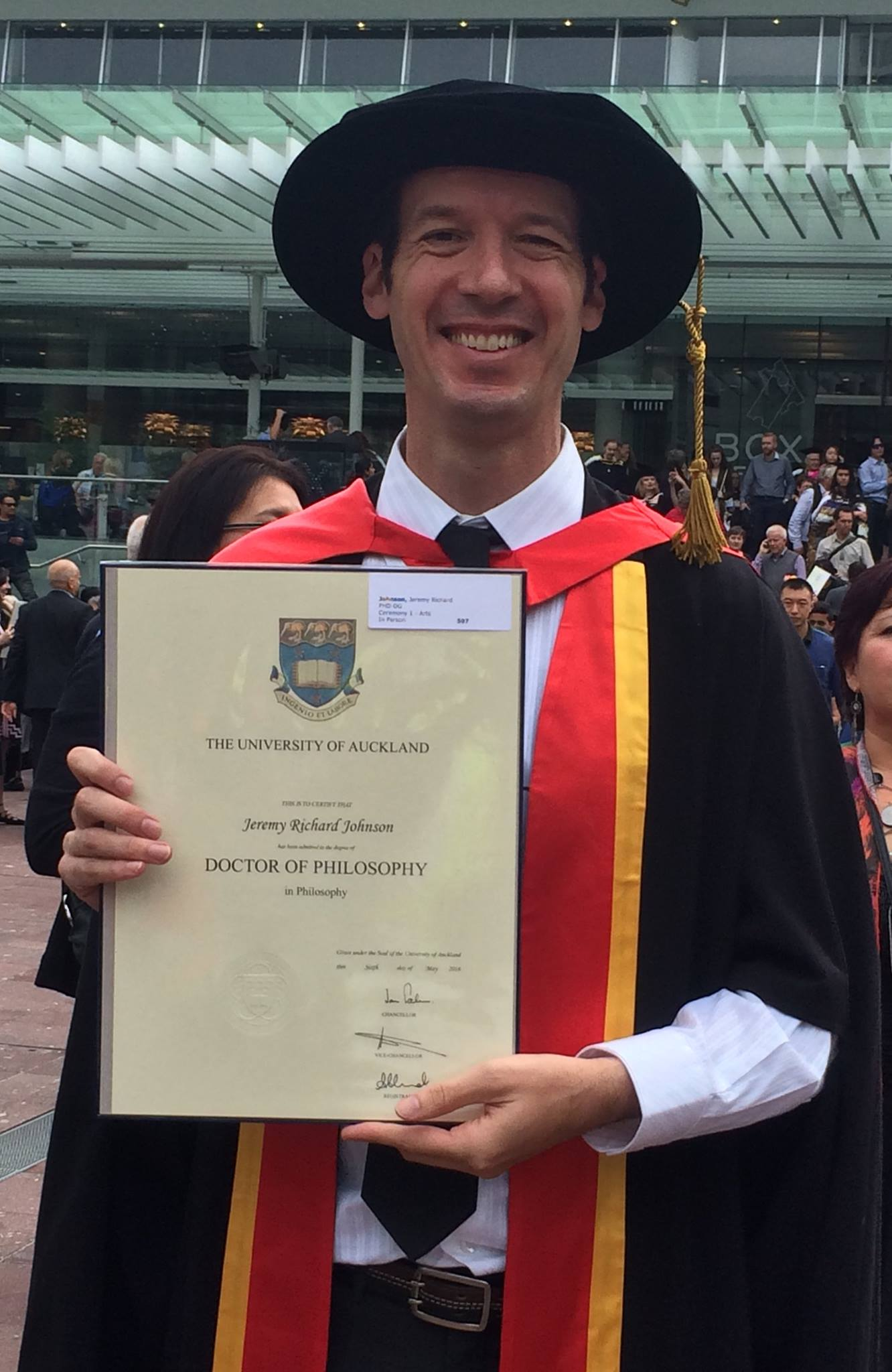 Jeremy holding his Phd